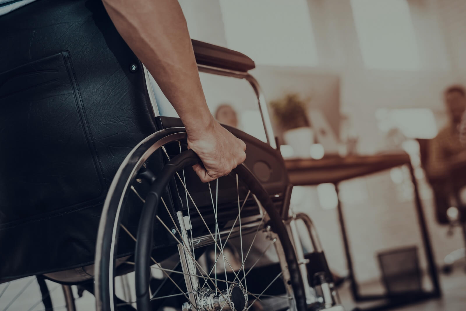 Main in wheelchair in office setting